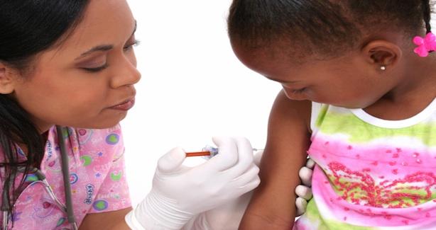 Child receiving immunization shot