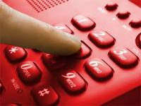 finger dailing red telephone
