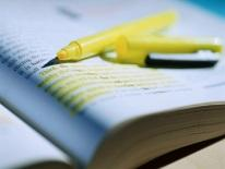 Photo of a text book and highlighter