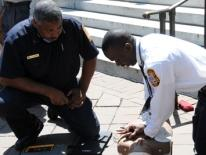 Members of DC Fire & EMS perform CPR