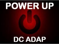 """Close up of a power switch with text """"Power Up, DC ADAP"""""""